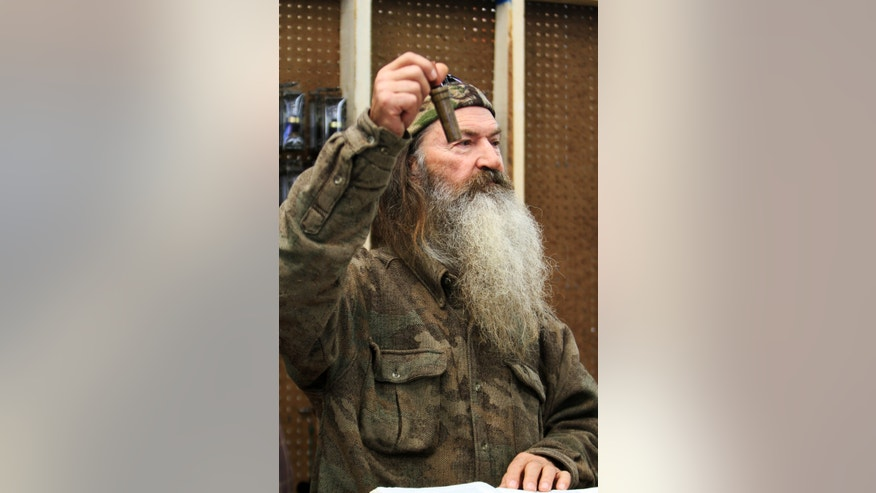 "File-This Nov. 7, 2013 file photo shows Phil Robertson, the Duck Commander, holding the 1 millionth duck call assembled for 2013 at company's warehouse in West Monroe, La. The A&E channel says ""Duck Dynasty"" patriarch Robertson is off the show indefinitely after condemning gays as sinners in a magazine interview. In a statement Wednesday,  Dec. 18, 2013, A&E said it was extremely disappointed to read Robertson's comments in GQ magazine. (AP Photo, The News-Star/Margaret Croft)     NO SALES"