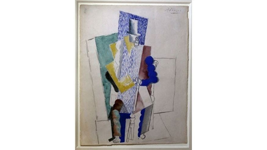 December 12, 2013: Picasso's 1914 cubist drawing L'homme au Gibus, Man with Opera Hat, is presented at Sotheby's auction house in Paris. (AP Photo)