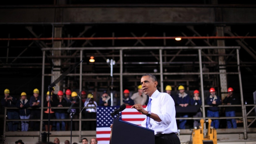 FILE - In this Nov. 14, 2013, file photo, President Barack Obama speaks at ArcelorMittal, a steel mill in Cleveland. The Commerce Department releases final third-quarter gross domestic product on Friday, Dec. 20, 2013. (AP Photo/Pablo Martinez Monsivais, File)