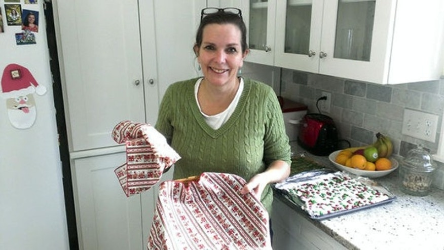 Dec. 20, 2013: Anne Tabat holds the now-empty cookie basket which once was her weapon for getting neighbors to know each other in Chanhassen, Minn. Tabat, a mother who has been baking cookies for the kids on her children's bus for 15 years has been shut down by an anonymous complaint.