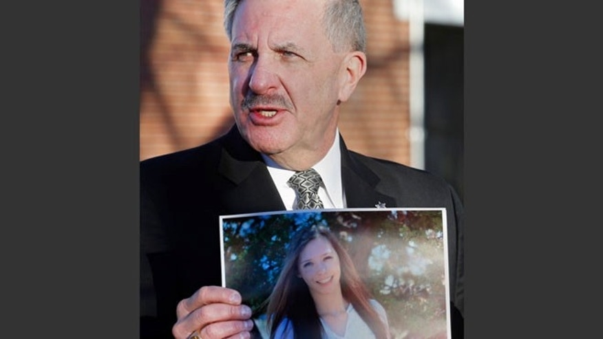 Dec. 14, 2013: Arapahoe County Sheriff Grayson Robinson holds a picture of Claire Davis, the 17-year-old student who was shot in the head by a classmate, during a briefing at Arapahoe High School in Centennial, Colo.