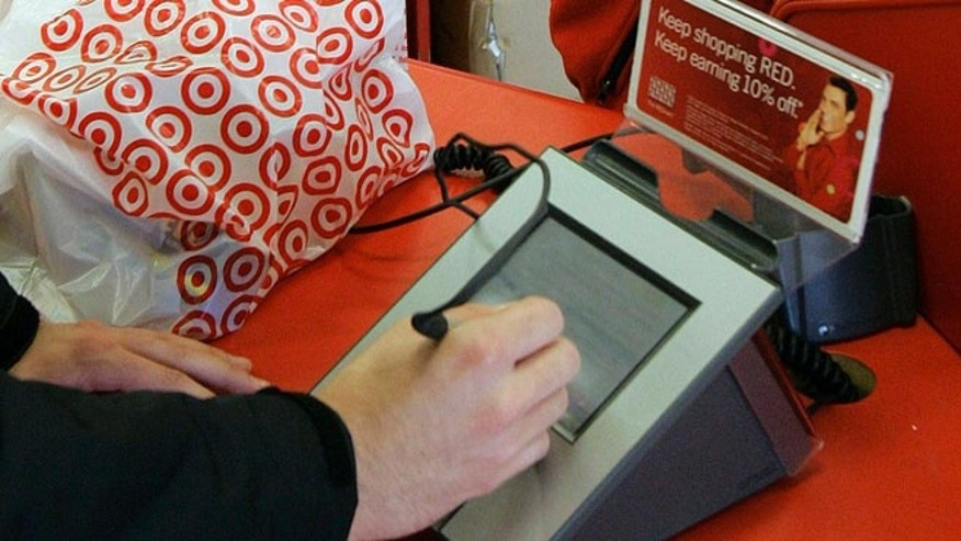 In this Jan. 18, 2008 file photo, a customer signs his credit card receipt at a Target store in Tallahassee, Fla. The U.S. is the juiciest target for hackers hunting credit card information. And experts say incidents like the recent data theft at Target's stores will get worse before they get better. That's in part because U.S. credit and debit cards rely on an easy-to-copy magnetic strip on the back of the card, which stores account information using the same technology as cassette tapes.