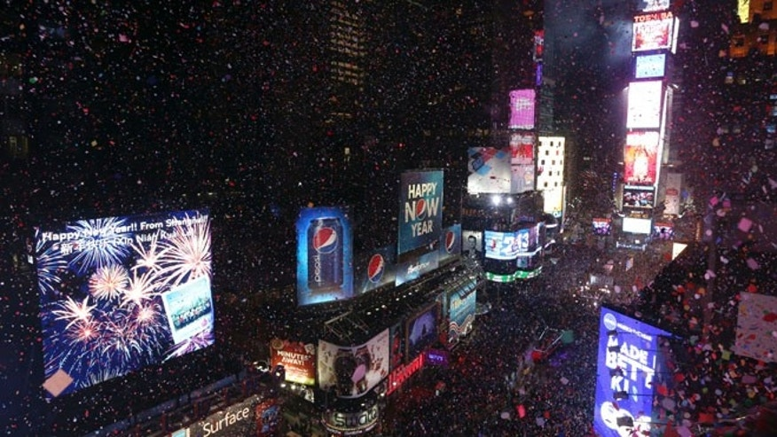 Jan. 1, 2013: Confetti flies over New York's Times Square after the clock strikes midnight during the New Year's Eve celebration.