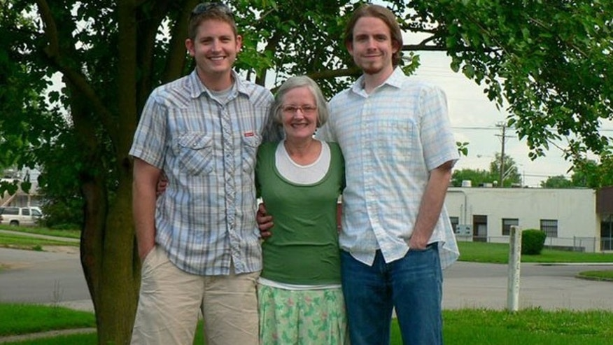 Aaron Collins, left, Seth Collins, right, and their mother, Tina.