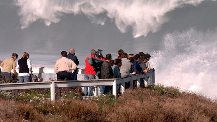 FILE: Dec. 21, 2005: Spectators line the bluff to watch high surf at La Jolla Cove in La Jolla, San Diego, California.