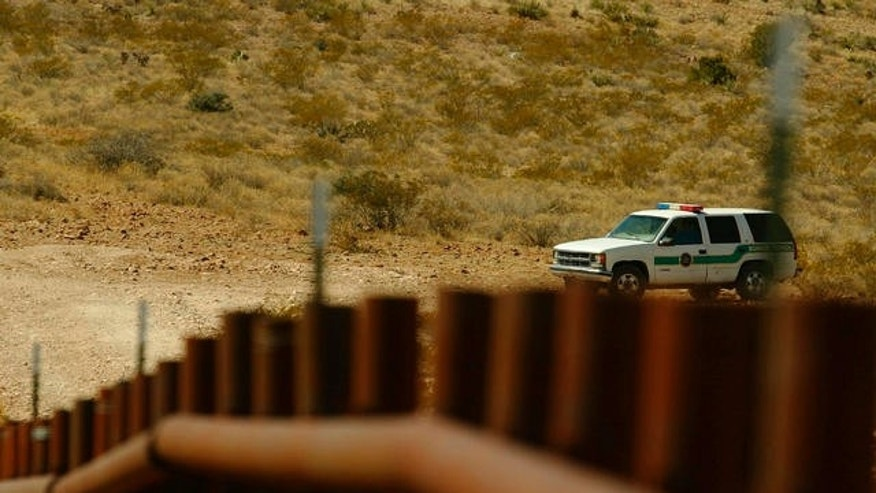 A border patrol car looks over the town of Las Chepas, Mexico near the border with New Mexico.