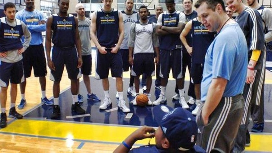 De. 29, 2013: 8-year old Charvis Brewer attends practice with the Memphis Grizzlies.