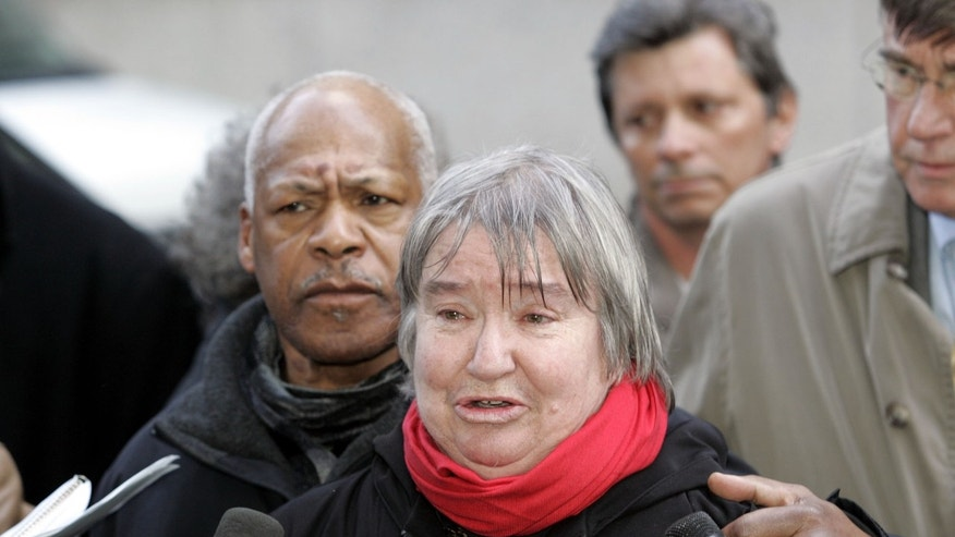 FILE - In this Feb. 10, 2005  file photo, attorney Lynne Stewart cries as she speaks to the press with her husband Ralph Pointer next to her, left, outside Federal Court in New York.  Stewart, a former civil rights lawyer convicted in a terrorism case and sentenced to 10 years in prison is entitled to compassionate release because she has less than 18 months to live, prosecutors and the Federal Bureau of Prisons told a judge on Tuesday, Dec. 31, 2013. (AP Photo/David Karp, File)