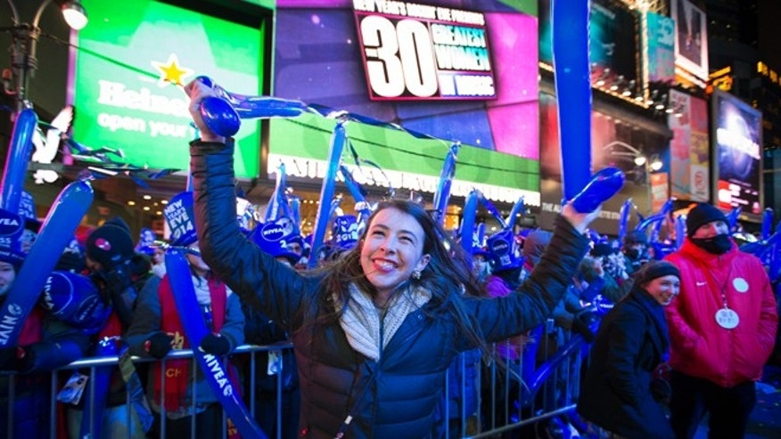 Dec. 31, 2013: Betsy Bryant, of Nashville, dances in the buffer beside the performance stage during the New Year's Eve celebrations in Times Square.