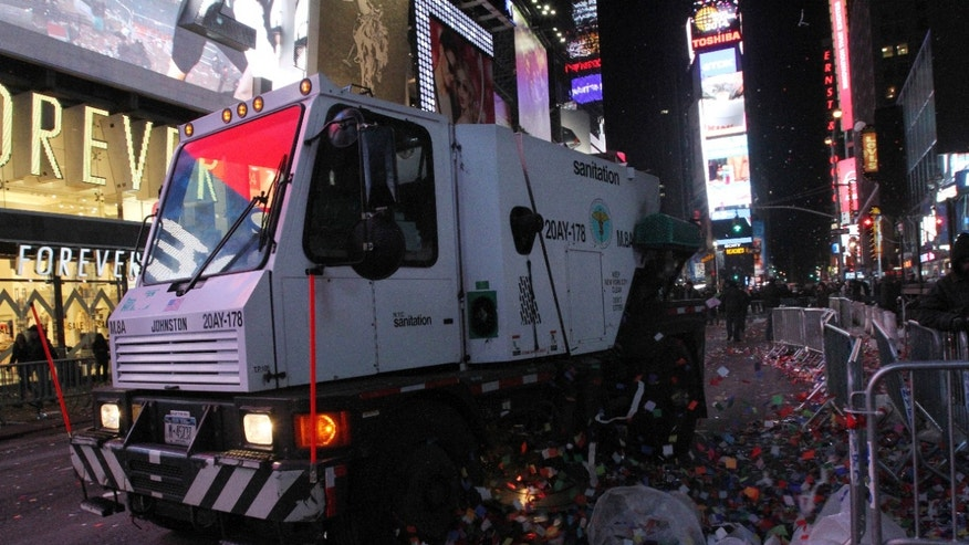 A sanitation truck cleans the debris in New York's Times Square early New Year's Day Wednesday Jan. 1, 2014. (AP Photo/Tina Fineberg)