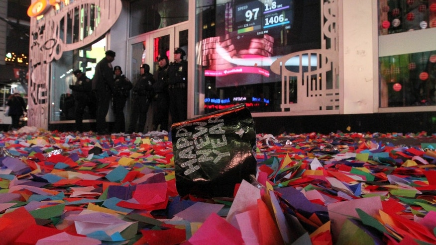 Confetti and other debris is seen in New York's Times Square early New Year's Day Wednesday Jan. 1, 2014. (AP Photo/Tina Fineberg)