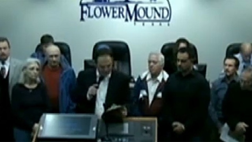 "Mayor Tom Hayden declares 2014 the ""year of the Bible"" at a city council meeting in Flower Mound, Texas."