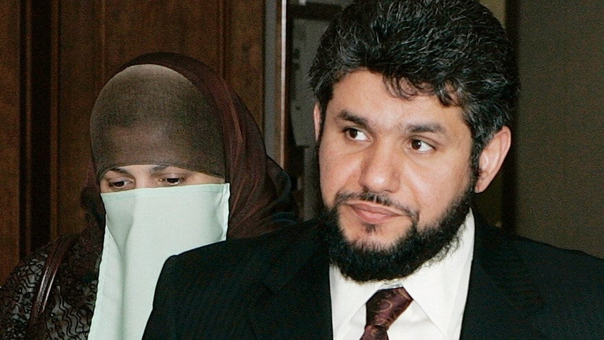 FILE - This May 12, 2006, file photo shows Homaidan al-Turki, right, and his wife Sarah Khonaizan as they arrive for a hearing at the Arapahoe County courthouse in Centennial, Colo. A Colorado judge on Thursday, Jan. 2, 2014, denied the Saudi man's request to return to his home country to complete his prison term for sexually abusing his Indonesian housekeeper and keeping her as a virtual slave. (AP Photo/Ed Andrieski, File)