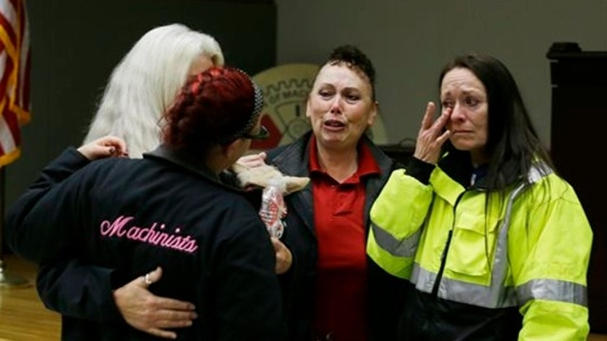 Jan. 3, 2014: Boeing workers cry after learning that voters in District 751 of the Boeing machinists union voted to accept Boeing's latest contract offer to keep the assembly of the Boeing 777X airplane in Washington state in Seattle.