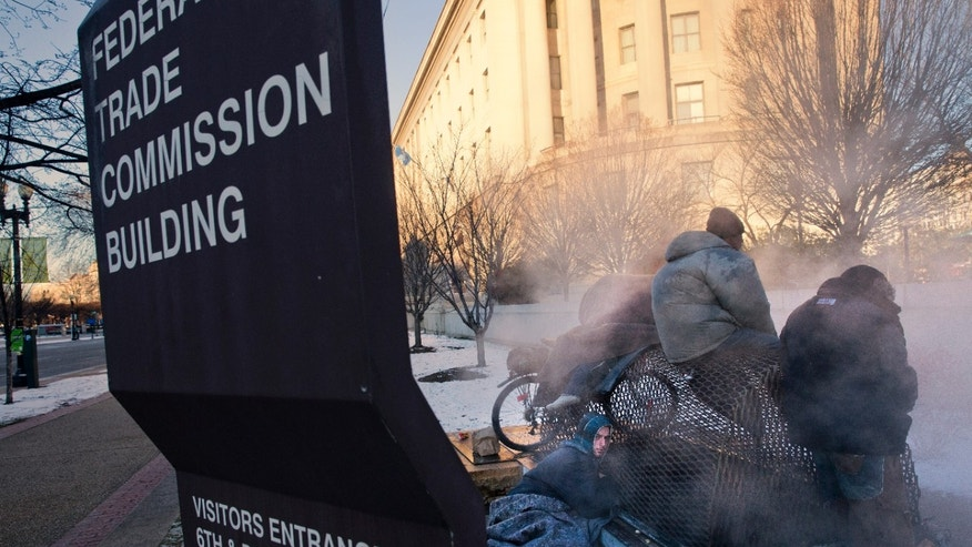 Nicholas Simmons, 20, of Greece, N.Y.,left,   warms himself on a steam grate with three homeless men by the Federal Trade Commission, just blocks from the Capitol, during frigid temperatures in Washington, Saturday, Jan. 4, 2014.  On New Year's Day, Simmons disappeared from his parents' house in a small upstate New York town, leaving behind his wallet, cellphone and everything else. Four days later, an Associated Press photographer, looking for a way to illustrate unusually cold weather, took his picture as he warmed himself on a steam grate a few blocks from the U.S. Capitol. His parents Paul and Michelle Simmons saw the photograph in USA Today Sunday morning after it was brought to their attention through a Facebook page set up to help find their son, according to police and family friends, and were able to report his location to D.C. police who transported him to a hospital where he was reunited with his father and brother who drove all day to find him. (AP Photo/Jacquelyn Martin)