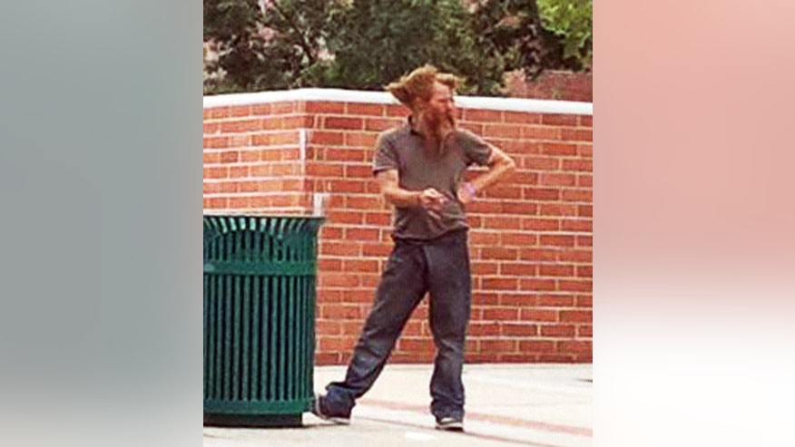 FILE - This undated file photo provided by Ron Thomas shows his son, Kelly Thomas, while he was homeless. Kelly Thomas was involved in altercation with two Fullerton police officers at a bus station, and died days later. Two officers, Manuel Ramos, and Jay Ciccinelli, are on trial on charges related to his death.  Closing arguments are scheduled to begin Tuesday, Jan. 7, 2013. (AP Photo/Courtesy Ron Thomas, File)