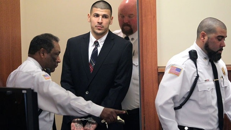 December 23, 2013: Former New England Patriots NFL football player Aaron Hernandez is led into his court appearance at the Fall River Superior Court in Fall River, Mass. (AP Photo)