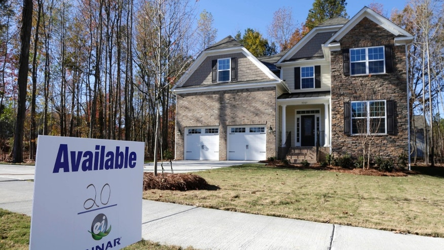 FILE - In this Nov. 14, 2013 file photo, a home is advertised for sale in Matthews, N.C. Freddie Mac, the mortgage company, releases weekly mortgage rates on Thursday, Jan. 9, 2014. (AP Photo/Chuck Burton, File)