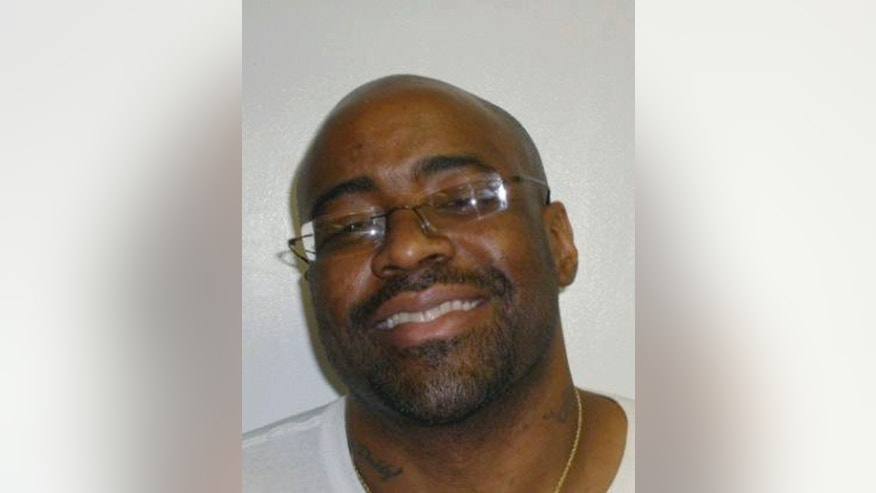 This June 29, 2011 photo provided by the Oklahoma Department of Corrections, shows Michael Lee Wilson. Convicted in the 1995 beating death of 30-year-old Richard Yost, Wilson is scheduled to be executed by lethal injection Jan. 9, 2014. Wilson was one of four men found guilty in the Feb. 26, 1995 murder. (AP Photo/Oklahoma Department of Corrections)
