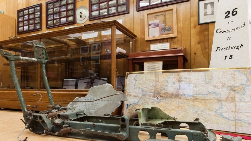Jan. 7, 2014: In this photo, remnants of an ejector seat and flight map recovered from an Air Force B-52 bomber that crashed 50 years ago are displayed at the Grantsville Community Museum in Grantsville, Md., near the site of the 1964 crash.