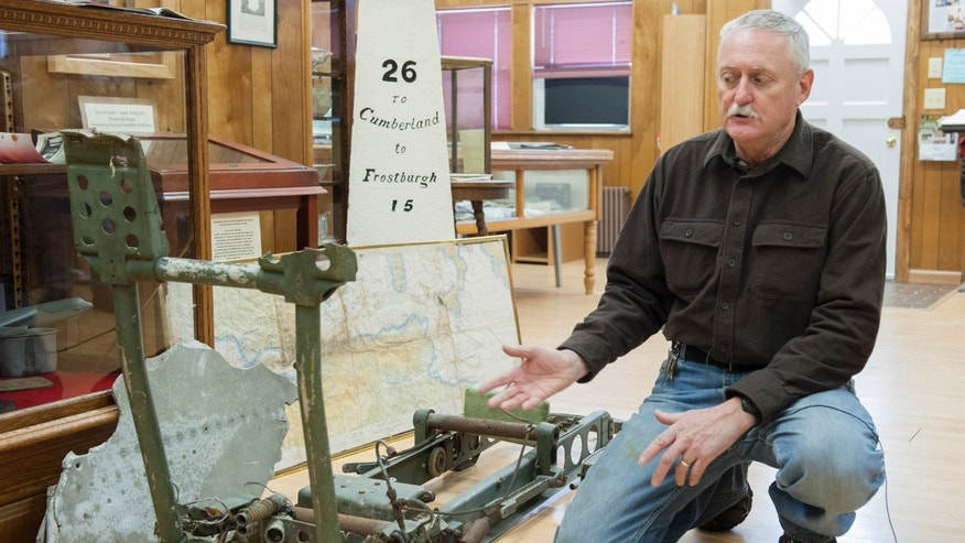 In this Jan. 7, 2014 photo, Rick Lewis speaks about the remnants of an ejector seat recovered from an Air Force B-52 bomber that crashed 50 years ago is displayed at the Grantsville Community Museum in Grantsville, Md., near the site of the 1964 crash. Residents of far western Maryland are recalling the 50th anniversary of the deadly crash. Three of the five crew members died in the storm-driven accident on Jan. 13, 1964. Local volunteers helped government workers recover the bodies and two unarmed nuclear bombs from the snow-covered scene. (AP Photo/Andrew Ferguson)