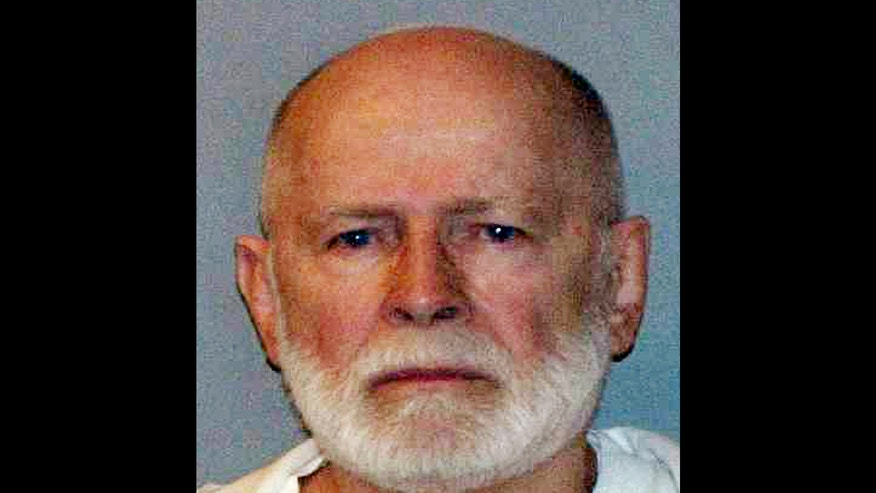 "FILE - This file June 23, 2011 booking photo provided by the U.S. Marshals Service shows James ""Whitey"" Bulger, captured in Santa Monica, Calif., after 16 years on the run. Authorities are planning to auction any ""items of value"" found in the California apartment where Bulger and his girlfriend hid out for years, a way to come up with at least some measure of compensation for the families of his victims. (AP Photo/U.S. Marshals Service, File)"