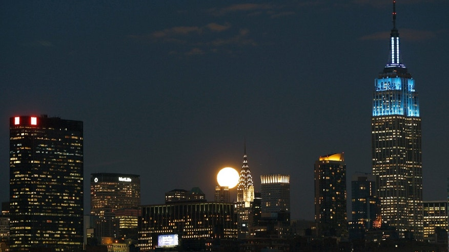 Feb. 7: A full moon rises between the Chrysler Building and the Empire State Building.
