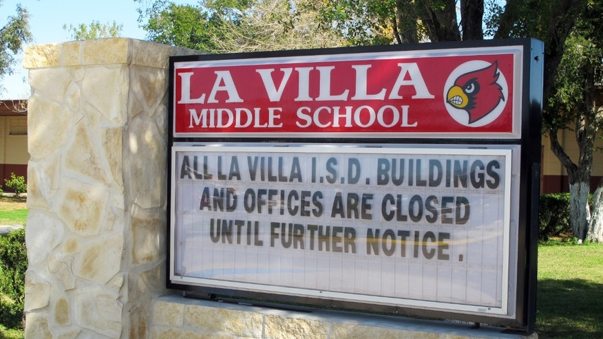A sign outside La Villa Middle School tells of the school district's status in La Villa, Texas, Monday, Jan. 13, 2014. Schools in La Villa were supposed to return to classes, but instead a water payment dispute with the city has shut the school down. (AP Photo/Chris Sherman)