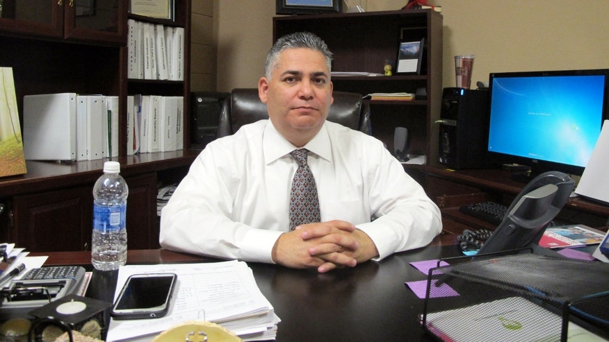 La Villa Independent School District Superintendent Narciso Garcia poses for a photo in his office in La Villa, Texas, Monday, Jan. 13, 2014. A water payment dispute between the city and school district has shut down the schools. (AP Photo/Chris Sherman)
