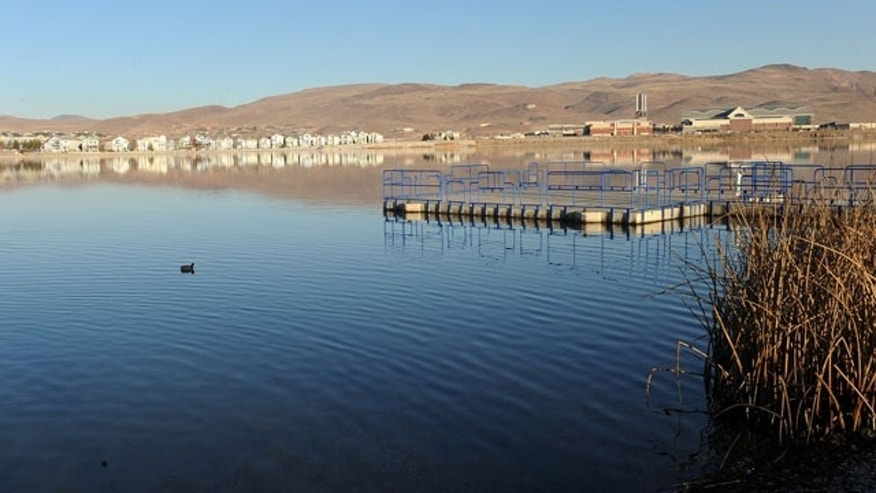January 14, 2014: In this Wednesday, Jan. 14, 2014 photo, the fishing pier on the Sparks Marina in Sparks, Nev. is empty as it appears all the fish in the lake have died. As many as 100,000 trout, catfish, and bass have died due to low exygen levels in the lake, according to the Nevada Department of Wildlife. (AP Photo/The Reno Gazette-Journal, Andy Barron)