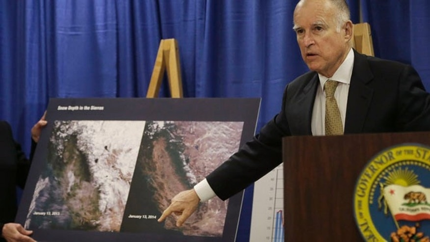 Jan 17, 2014: Gov. Jerry Brown points to images showing the snow depth in the Sierra mountains on Jan. 13, 2013, left, and Jan. 13, 2014, center, while declaring a drought state of emergency in San Francisco.