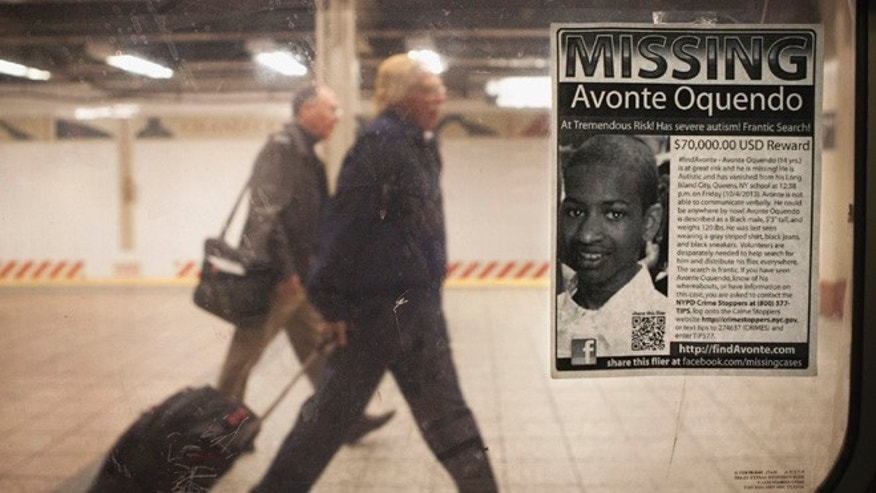 FILE: A missing poster for Avonte Oquendo, a 14-year-old autistic boy who has been missing for 3 weeks since walking out of his school, is posted on a subway window in the Times Square station.