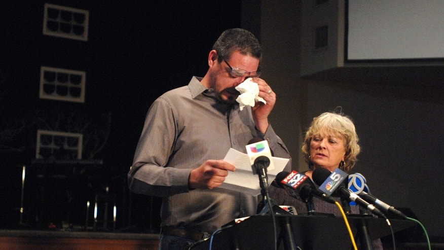 Krystle Dikes' father Shaun Dikes wipes tears from his eyes as he and his wife Charlotte address the media during a press conference at the First Baptist Church in Bristol, Ind. Saturday, Jan. 18, 2014.  Shawn Walter Bair of Elkhart shot and killed Krystle Dikes Wednesday night at a Martin's Super Market in Elkhart. He also killed 44-year-old shopper Rachelle Godfread before being fatally shot by police.  (AP Photo/The Elkhart Truth, Jennifer Shephard)