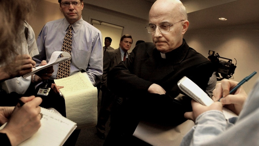 FILE - This April 17, 2002 file photo shows Chicago Cardinal Francis George listening to reporters' questions  before he left for Rome to meet with Vatican officials and other American cardinals about the child sex abuse scandals in the United States. Attorneys for sex abuse victims will post thousands of documents to a website Tuesday morning, Jan. 21, 2014, after receiving them from the Archdiocese of Chicago last week as part of legal settlements. Attorneys say the documents will show that the archdiocese concealed the abuse for decades. George says the disclosures are an attempt at transparency and to help victims heal. He's also apologized to victims and area Catholics for the abuse. (AP Photo/M. Spencer Green, File)