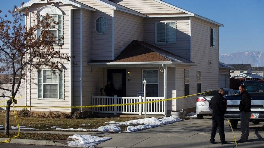 Investigators put police tape in front of a home, Friday, Jan. 17, 2014, in Spanish Fork, Utah, where five people were found dead on Thursday.  A 34-year-old officer shot and killed his wife, mother-in-law and two young children and turned the gun on himself, authorities said Friday.  Spanish Fork police said the five were found dead about 11 p.m. Thursday, when co-workers reported Joshua Boren didn't show up for his night shift as a patrol officer at the Lindon Police Department. (AP Photo/Daily Herald, Mark Johnston)