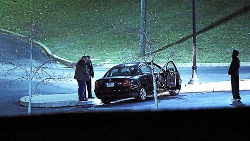 January 20, 2014: Police investigate a car, left, at the athletic center of Widener University in Chester, Pa. after a student was shot. Authorities warned students to remain indoors until further notice. (AP Photo/Delaware County Daily Times, Robert J. Gurecki)