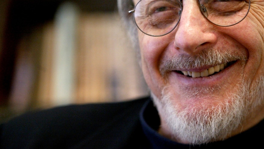 "FILE - In this April 27, 2004 file photo, author E.L. Doctorow smiles during an interview in his office at New York University. Doctorow's latest book, ""Andrew's Brain,""  takes on the ongoing debates about science vs. literature and humans vs. machines.  (AP Photo/Mary Altaffer, File)"