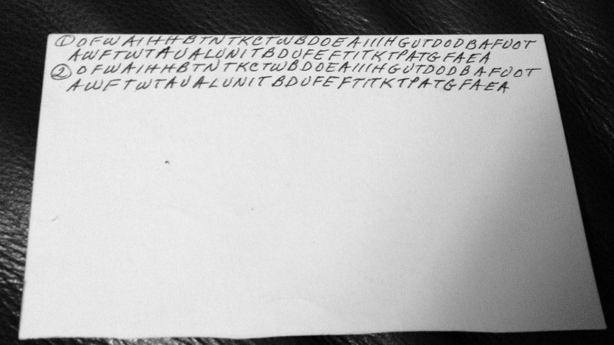 This undated family photo shows the back of an index card filled with letters written by Dorothy Holm. A brain tumor took away Holm's ability to speak, she picked up index cards and began filling them with seemingly random, indecipherable sequences of letters. Her grandchildren saw her scribbling and thought she was leaving them a code, but it was one the preteens couldn't crack. Her granddaughters, 18 years later, were able to solve the code with help from the Internet community. (AP Photo/Courtesy of Janna Holm)