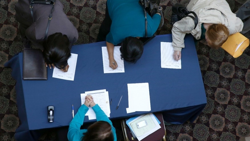 In this Wednesday, Jan. 22, 2014, photo, job seekers sign in before meeting prospective employers during a career fair at a hotel in Dallas. The Labor Department releases weekly jobless claims, on Thursday, Jan. 23, 2014. (AP Photo/LM Otero)