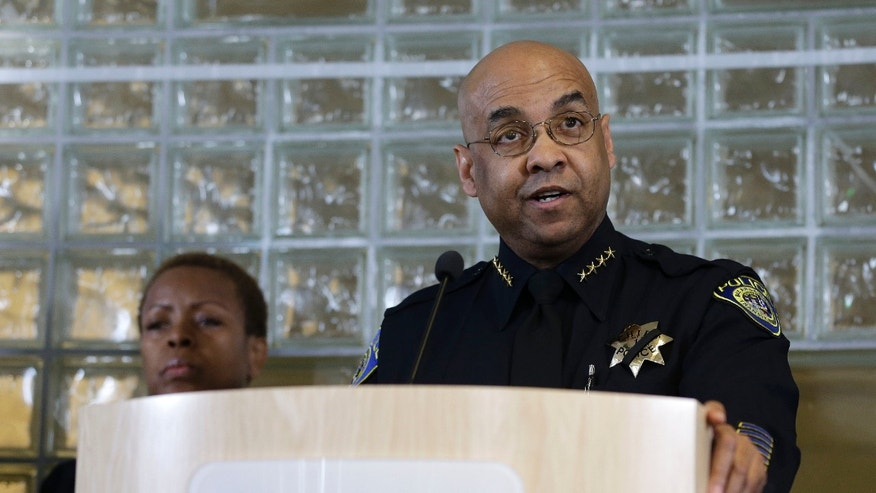 Bay Area Rapid Transit police chief Kenton Rainey, right, talks about the shooting of a BART officer who was killed by a fellow officer during a news conference Wednesday, Jan. 22, 2014, in Oakland, Calif. Authorities say a San Francisco Bay Area public transit officer who was shot and killed Tuesday by a fellow officer while searching an apartment was looking for a laptop and other stolen items. Rainey declined to disclose any further details of how the shooting of Sgt. Tom Smith occurred. A robbery suspect was in custody. (AP Photo/Eric Risberg)