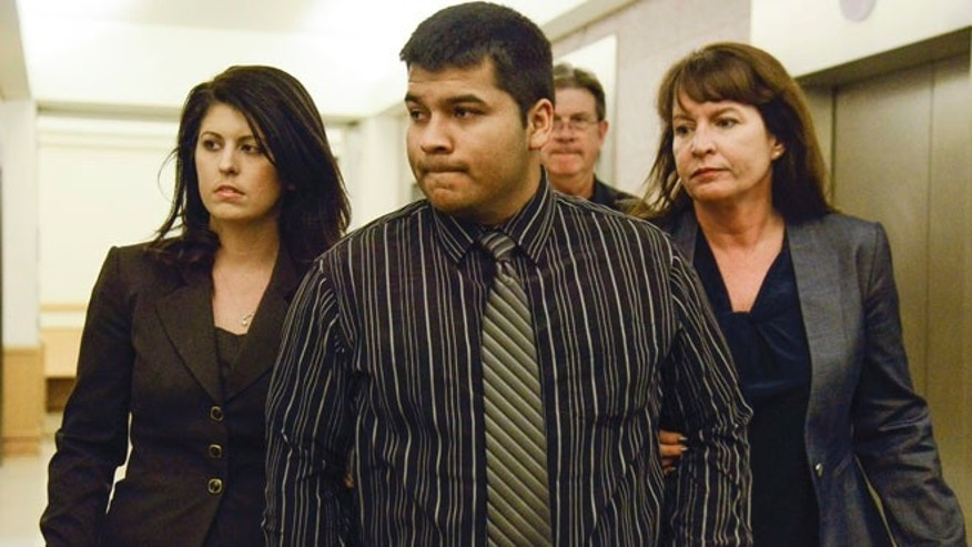 Jan. 24, 2014: Erick Munoz, center, husband of Marlise Munoz is escorted by attorneys as he walks to 96th District Court in Fort Worth, Texas.
