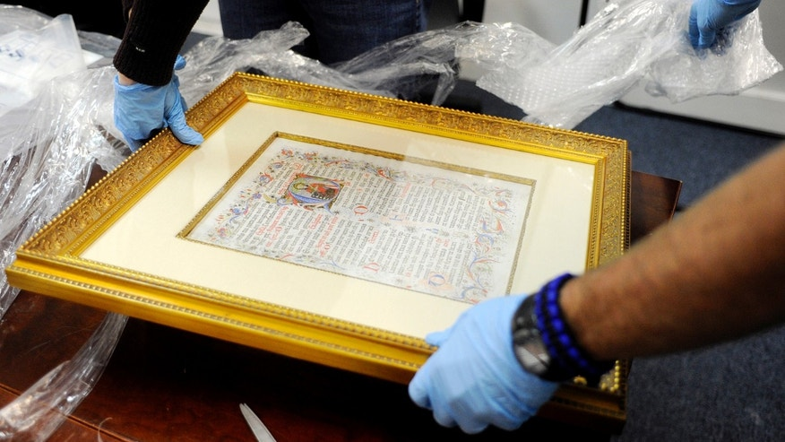 An Italian, religious manuscript that was stolen over 20 years ago in Italy is displayed Monday Jan. 27, 2014, in Tampa, Fla.. The Italian government and DHS worked together to track down the item to private owners in St. Petersburg, Fla. (AP Photo/The Tampa Tribune, Jay Conner)  ST. PETERSBURG OUT; LAKELAND OUT; BRADENTON OUT; MAGS OUT; LOCAL TV OUT; WTSP CH 10 OUT; WFTS CH 28 OUT; WTVT CH 13 OUT; BAYNEWS 9 OUT; THE TAMPA BAY TIMES OUT; LAKELAND LEDGER OUT; BRADENTON HERALD OUT; SARASOTA HERALD-TRIBUNE OUT; WINTER HAVEN NEWS CHIEF OUT