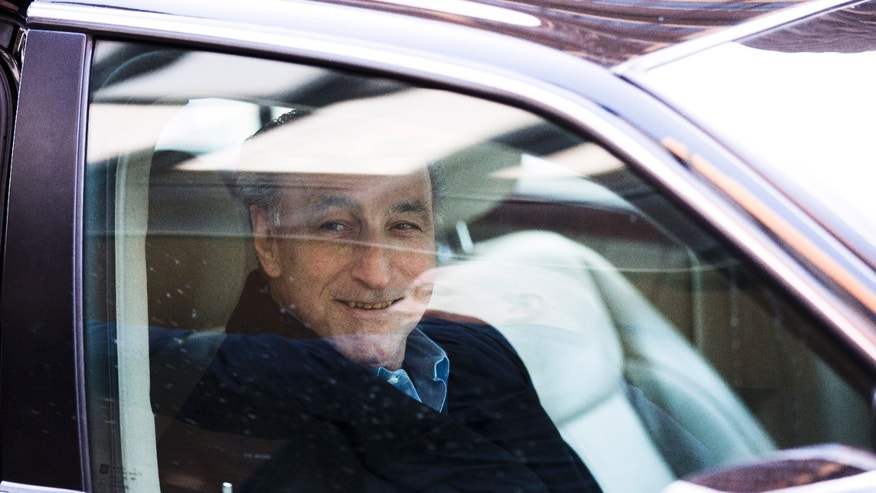 "Joseph ""Uncle Joe"" Ligambi smiles from a car after leaving the U.S. Courthouse, Tuesday, Jan. 28, 2014, in Philadelphia.  Federal prosecutors in Philadelphia have dropped its criminal case against the reputed Philadelphia mob boss after a second jury on Friday, Jan. 24, 2014, deadlocked on the central racketeering charge.  (AP Photo/Matt Rourke)"
