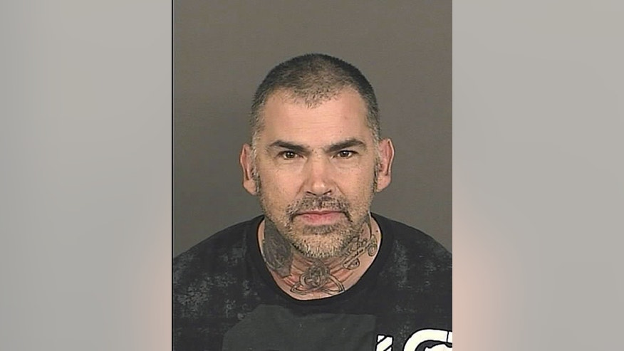 In this recent 2014 police mugshot photo provided by the Denver District Attorney's Office on Wednesday, Jan. 29, 2014, suspect Michael Todd Abromovich is pictured. Authorities say the Colorado man lured another man to a Denver motel with an offer of sex, then handcuffed and robbed him while posing as a U.S. marshal. (AP Photo/Denver District Attorney's Office)