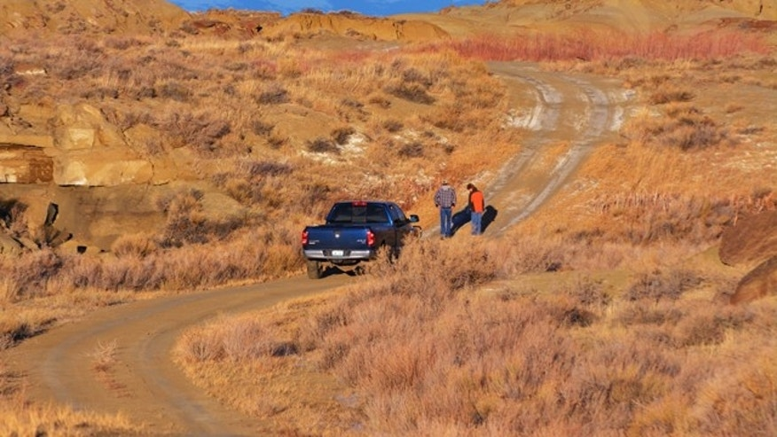 Jan. 12, 2014: A couple individuals spend some time, looking over the area in Badger Basin northwest of Powell, Wyo., where a  body was discovered days earlier.