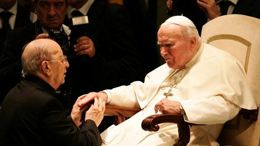 Nov. 30, 2004: Pope John Paul II blesses Father Marcial Maciel during a special audience in Paul VI hall at the Vatican.