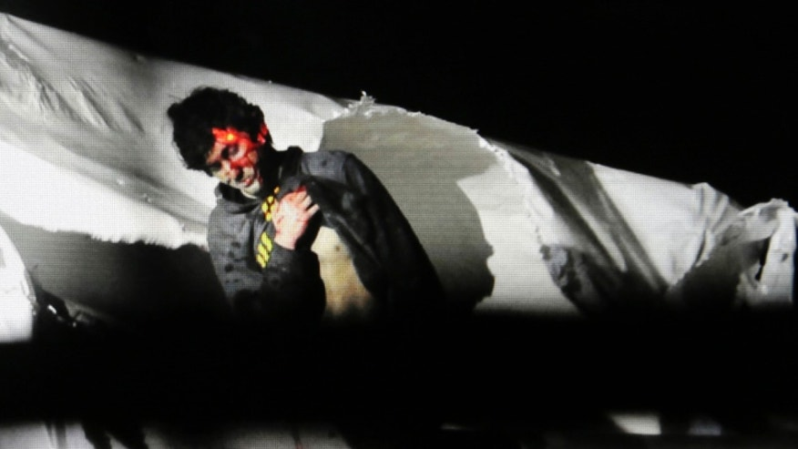FILE - In this Friday, April 19, 2013 Massachusetts State Police file photo, 19-year-old Boston Marathon bombing suspect Dzhokhar Tsarnaev, bloody and disheveled with the red dot of a sniper's rifle laser sight on his head, emerges from a boat at the time of his capture by law enforcement authorities in Watertown, Mass. On Thursday, Jan. 30, 2014, U.S. Attorney General Eric Holder authorized the government to seek the death penalty in the case against Tsarnaev. (AP Photo/Massachusetts State Police, Sean Murphy, File)