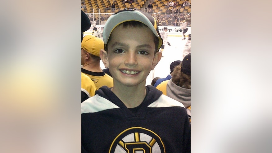 FILE - This April 11, 2013 photo provided by the Richard family shows, Martin Richard, 8, in Boston. Martin was the youngest of three people killed in the  Monday, April 15, 2013, bombings near the finish line of the Boston Marathon. The charitable foundation started by his parents announced Thursday, Jan. 30, 2014, it had selected 72 runners from more than 250 people in 35 states and several other countries who submitted 11-page applications to run as a team in the marathon on April 21, 2014. Charity teams are forming to run in honor of victims of the bombings at last year's race. (AP Photo/Bill Richard, File)