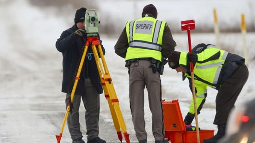Jan. 30, 2014: Officers from the St. Clair County Sheriff's Department investigate a scene where bags of human remains were discovered at the intersection Allington and Fred Moore Highway in St. Clair Township, Mich.