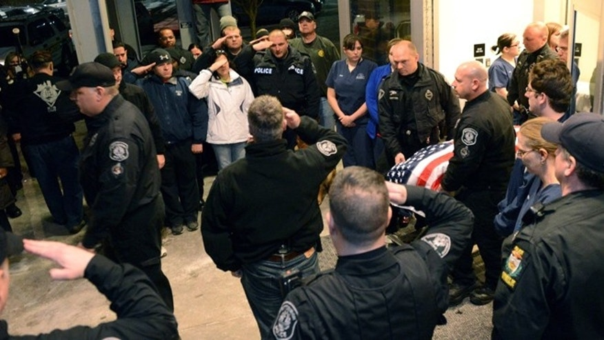 Jan. 30: Rocco, the German shepherd Pittsburgh police K-9 officer, is carried out in a flag covered casket as Pittsburgh Police officers salute as medical staff joins them at the Pittsburgh Veterinary Specialty Emergency Center.